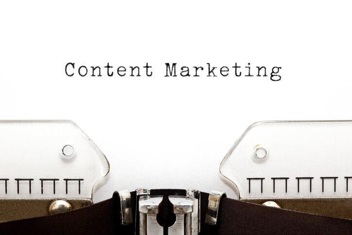 content-marketing-typed-in-black-ink-on-white-paper-in-typewriter