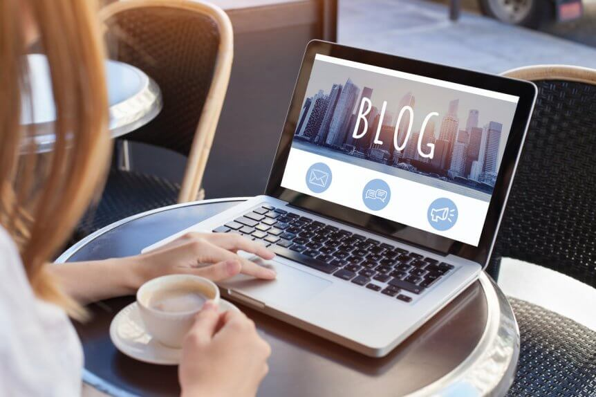 woman-working-on-business-blog-while-sitting-with-cup-of-coffee-at-table